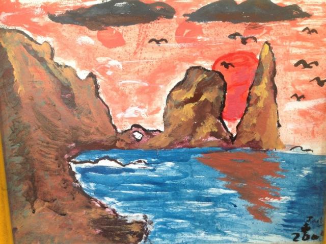 學校壁畫,畫的是蘭嶼夕陽。(照片由作者提供)